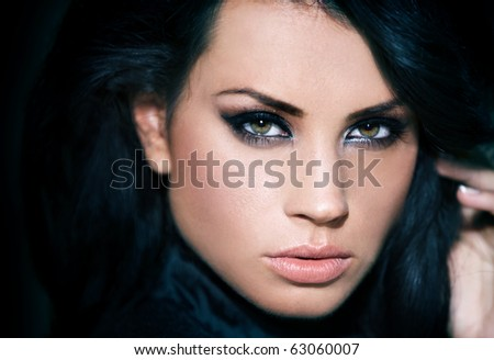 Portrait of beautiful woman isolated on black with copyspace - stock photo