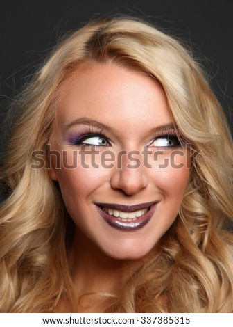 Portrait of beautiful woman, isolated on gray background