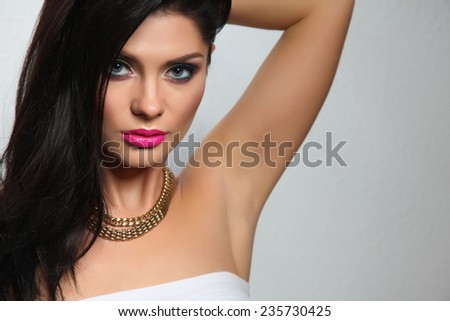 Portrait of beautiful woman, isolated on grey background - stock photo