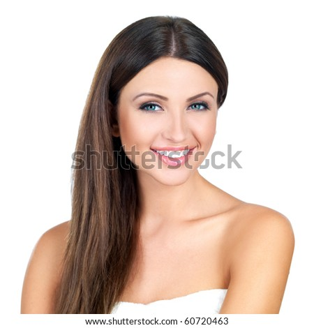 Portrait of beautiful woman looking at camera - stock photo