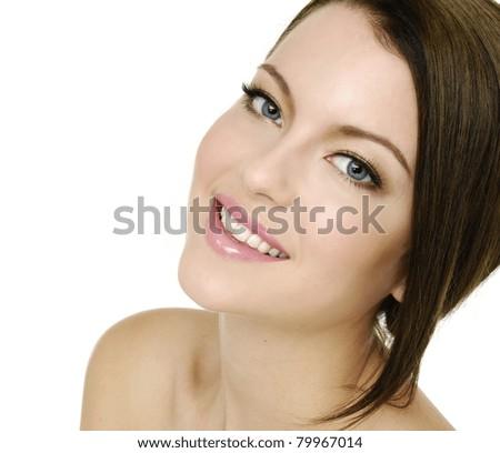 Portrait of beautiful woman looking at camera - stock photo