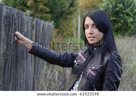 Portrait of beautiful woman near fence. More images of this models you can find in my portfolio