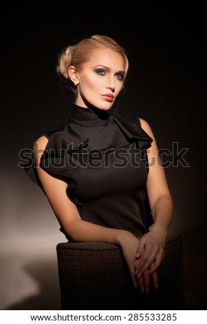 Portrait of beautiful woman on black background - stock photo