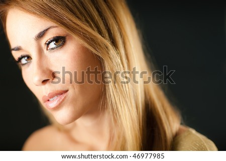 portrait of beautiful woman on black background, looking at camera. Horizontal shape, copy space - stock photo