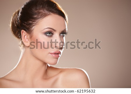Portrait of beautiful woman on natural background - stock photo