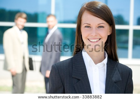 Portrait of beautiful woman on the background of business people