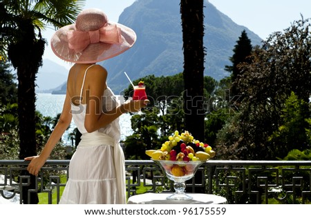 portrait of beautiful woman on the terrace, back view - stock photo