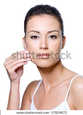 Portrait of beautiful woman pinching skin on her cheek - isolated on white - stock photo