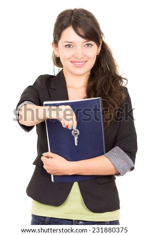 portrait of beautiful woman  real estate agent holding a key isolated on white - stock photo