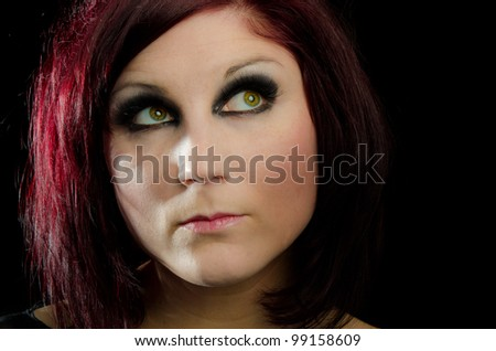 Portrait of beautiful woman red hair and strong makeup