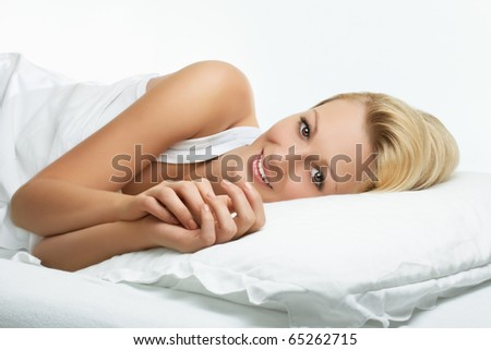 Portrait of beautiful woman relaxing on the bed. - stock photo