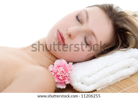 Portrait of beautiful woman resting on bamboo mat