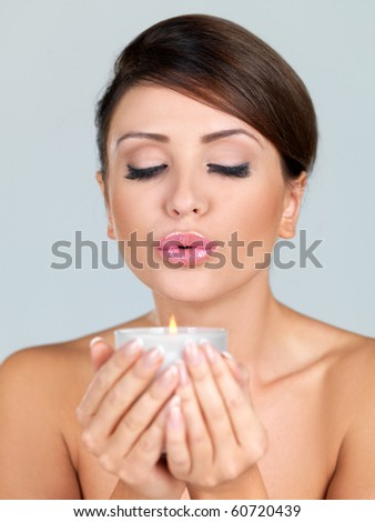 Portrait of beautiful woman, she holding candle - stock photo