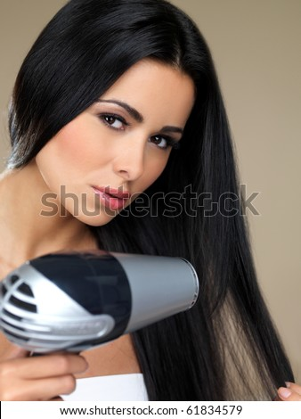 Portrait of beautiful woman, she holding hair dryer - stock photo