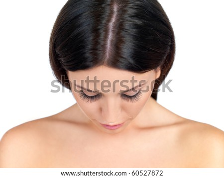Portrait of beautiful woman, she is looking down - stock photo
