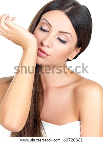 Portrait of beautiful woman she smells pefrume on her hand - stock photo