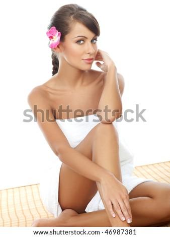 Portrait of Beautiful woman sitting on bamboo mat - stock photo