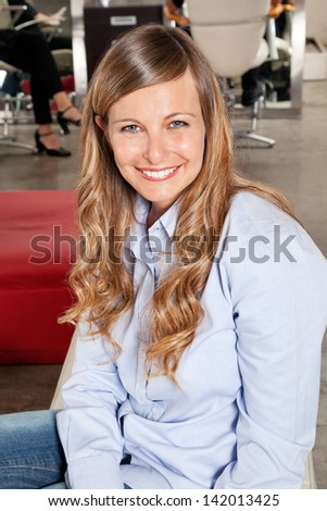 Portrait of beautiful woman smiling in parlor - stock photo