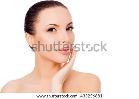 Portrait of beautiful woman touching face after plastic - stock photo