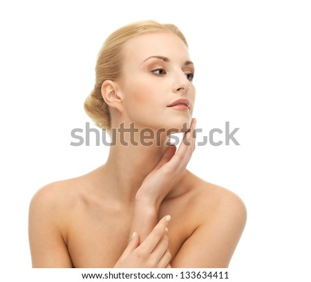 portrait of beautiful woman touching her face skin - stock photo