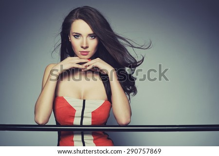 Portrait of beautiful woman wearing nice dress. Studio shoot. Healthy long hair - stock photo