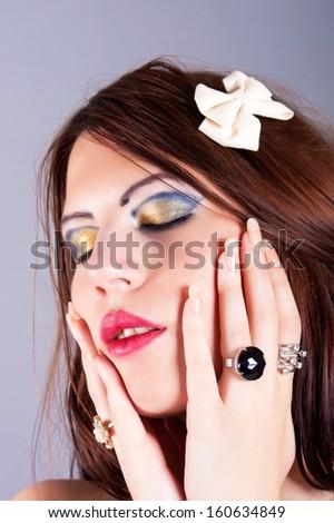portrait of beautiful woman wearing rings - stock photo