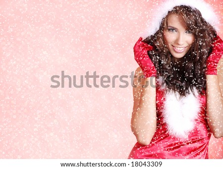 Portrait of beautiful woman wearing sexy santa claus clothes on snow flakes red background - stock photo