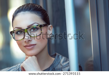 Portrait of beautiful woman wearing spectacles. Close up of young businesswoman, daylight - outdoors - stock photo