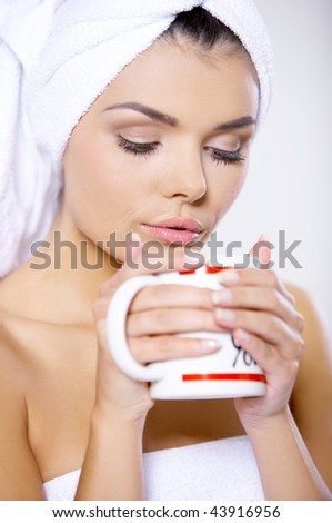 Portrait of beautiful woman wearing towel on her head