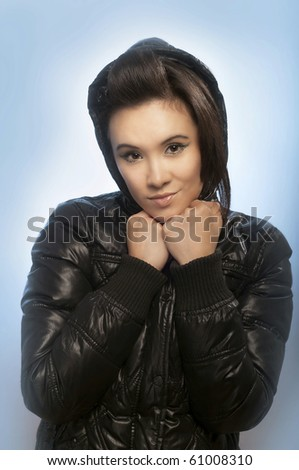 Portrait of beautiful woman wearing winter clothes - stock photo