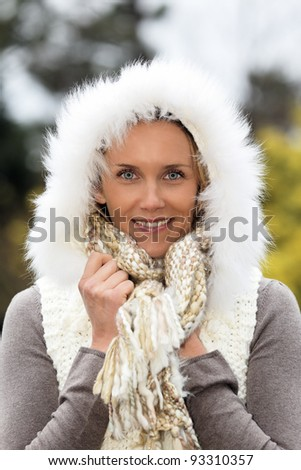 portrait of beautiful woman with blue eyes in winter - stock photo