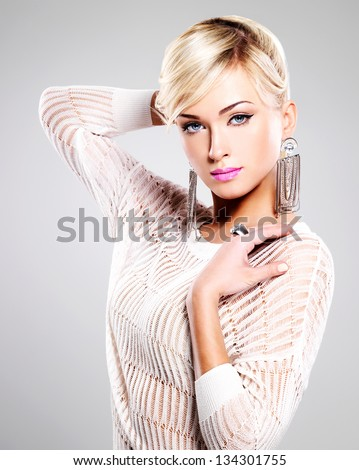 Portrait of beautiful woman with bright fashion makeup and white hairs.