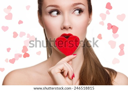 Portrait of Beautiful woman with bright makeup and red heart in hand - stock photo