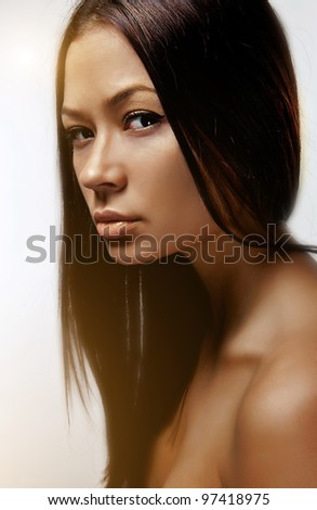 Portrait of beautiful woman with brown hair on white background - stock photo
