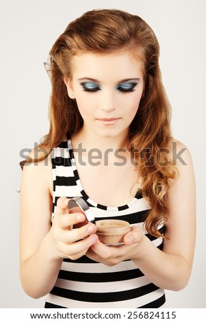 Portrait of beautiful woman with cream in her hands. - stock photo