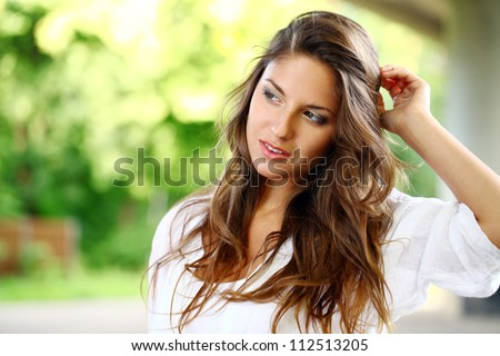 Portrait of beautiful woman with curly hair - stock photo