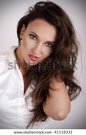 Portrait of beautiful woman with dark hair, perfect makeup on white background
