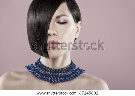 Portrait of beautiful woman with eyes closed - stock photo