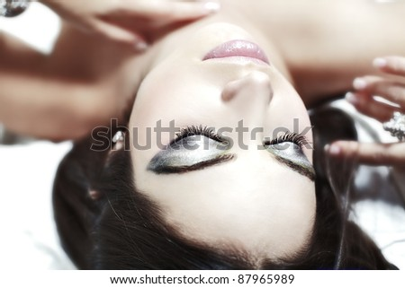 Portrait of beautiful woman with eyes closed