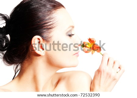 Portrait of beautiful woman with flower on white background