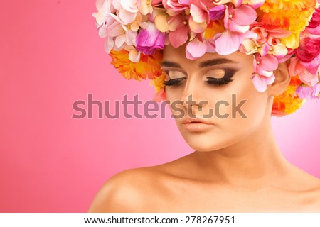 Portrait of beautiful woman with flower wreath.