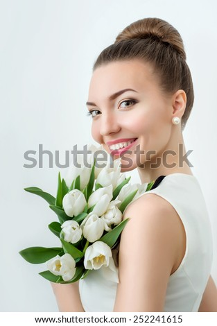 Portrait of beautiful woman with flowers. Professional make up.