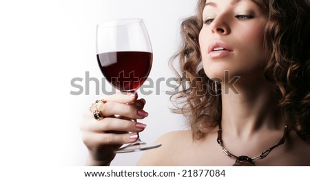 Portrait of beautiful woman with glass red wine on white background - stock photo