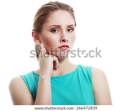 Portrait of beautiful woman with hand on chin - stock photo