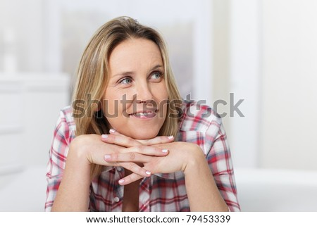 portrait of beautiful woman with head on the hands - stock photo