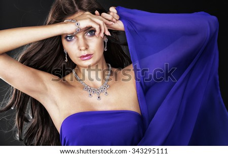 Portrait of beautiful woman with jewelry. - stock photo