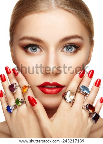 Portrait of beautiful woman with jewelry. Manicure and makeup. Perfect skin. Fashion beauty. Ring. Blonde girl. Close up - stock photo