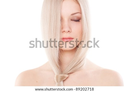 Portrait of beautiful woman with long blond hair over white - stock photo