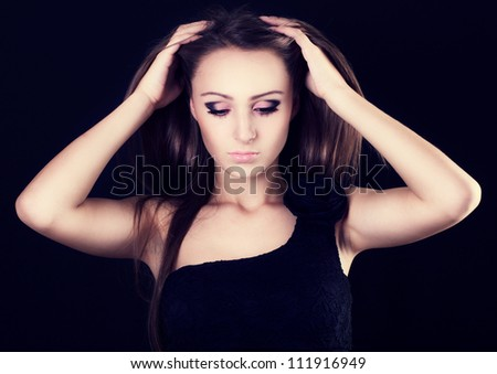 portrait of beautiful woman with long hair - stock photo
