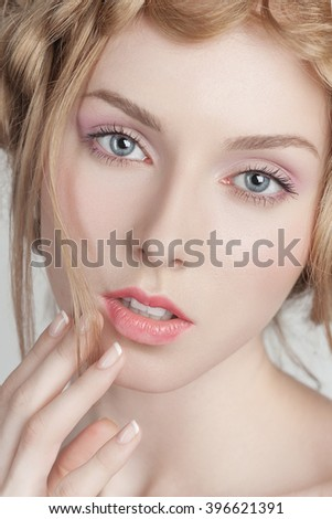 Portrait of beautiful woman with makeup and hairstyle